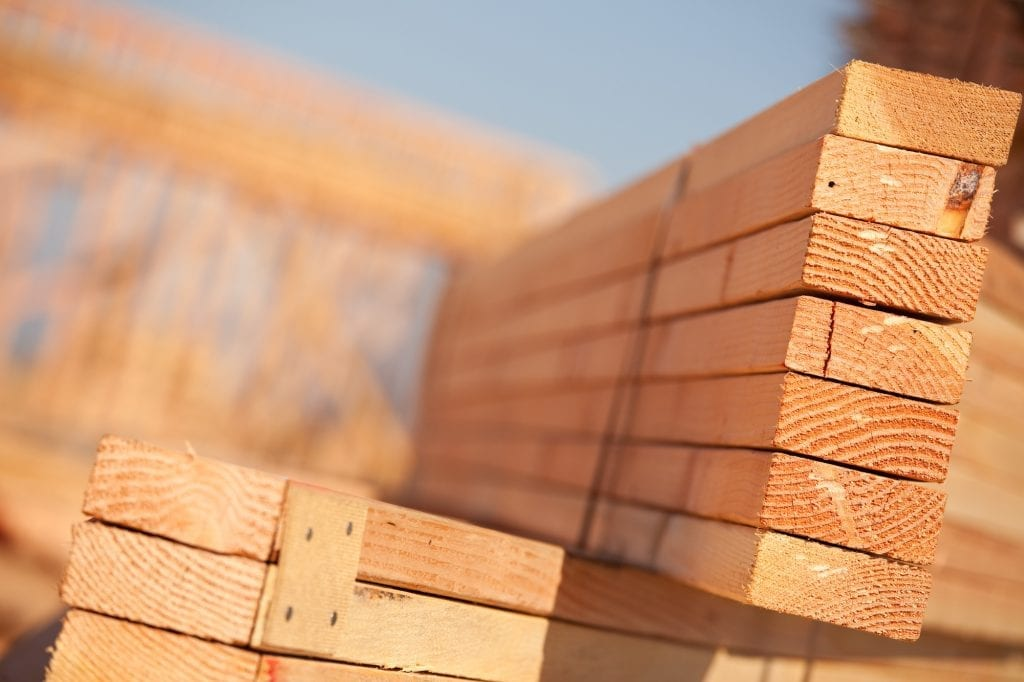 A close up of building materials in a lumber yard in Kelowna